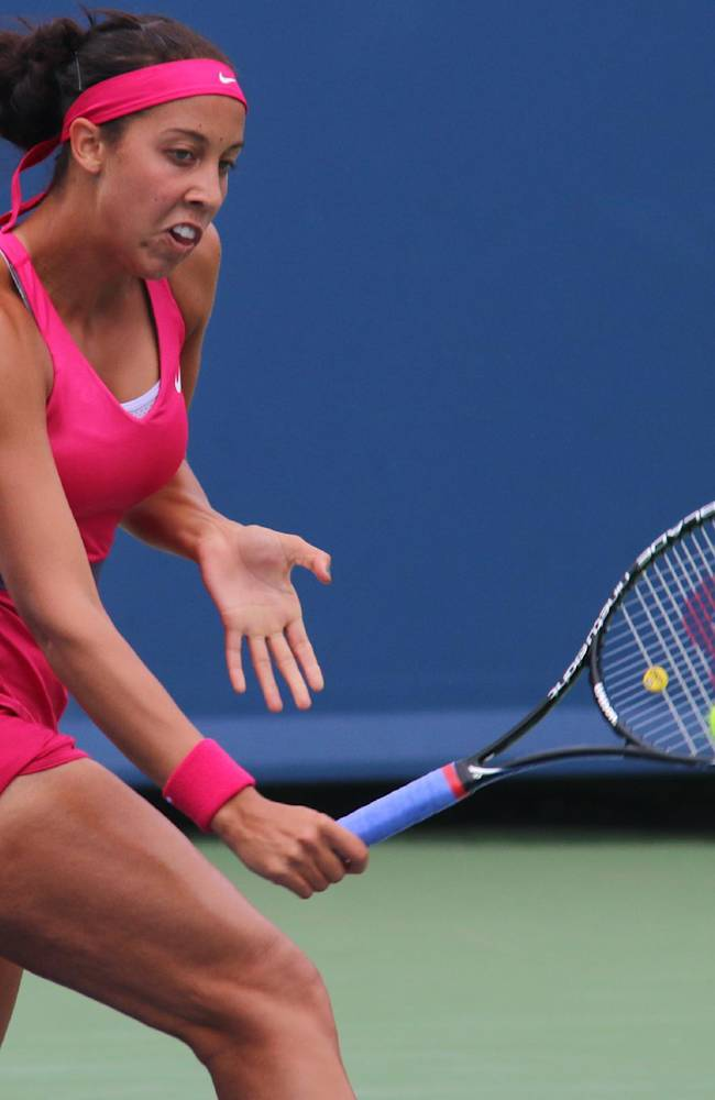 Madison Keys returns a volley to Maria Sharapova, of Russia, at the Western & Southern Open tennis tournament, Tuesday, Aug. 12, 2014, in Mason, Ohio