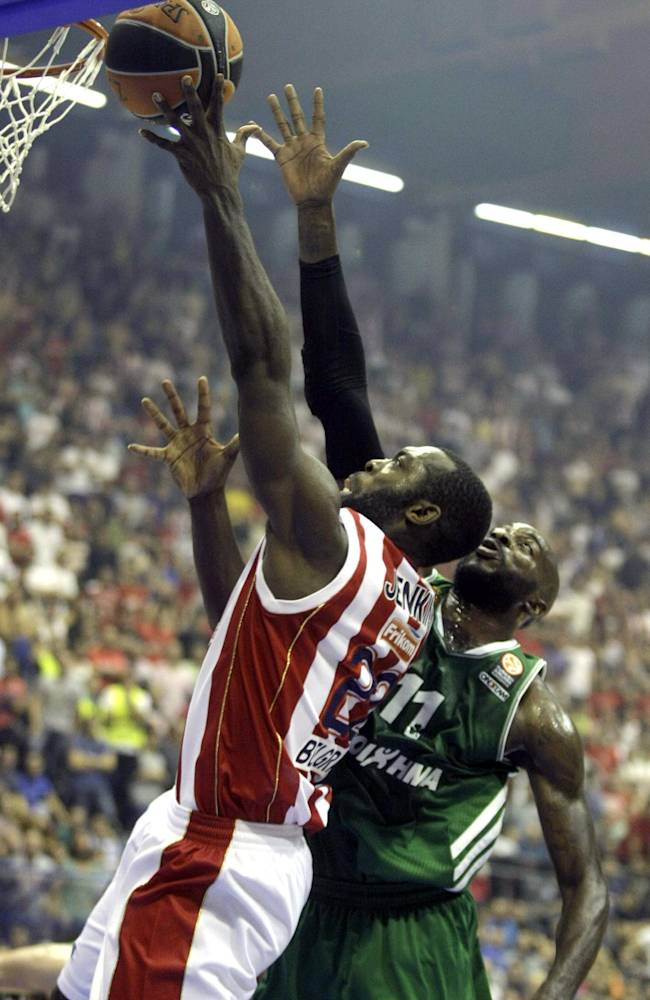 Red Star Belgrade's Charles Jenkins, left, scores past Stephane Lasme of Panathinaikos Athens during their Round 3 Euroleague basketball match in Belgrade, Serbia, Friday, Nov. 1, 2013