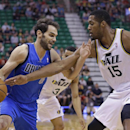 Utah Jazz's Derrick Favors (15) reaches for the ball as Dallas Mavericks' Jose Calderon (8), of Spain, drives during the first quarter during an NBA basketball game Tuesday, April 8, 2014, in Salt Lake City The Associated Press
