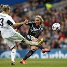 Lyon's Amandine Henry, right, shoots past Wolfsburg's Zsanett Jakabfi during the women's Champions League final soccer match between Wolfsburg and Olympique Lyonnais at Stamford Bridge Stadium in London Thursday, May 23, 2013.  (AP Photo/Matt Dunham)