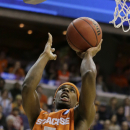 Syracuse forward C.J. Fair (5) shoots during the first half of the East Regional final in the NCAA men's college basketball tournament, Saturday, March 30, 2013 in Washington. (AP Photo/Alex Brandon)
