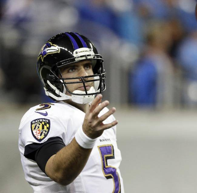 Baltimore Ravens quarterback Joe Flacco reaches for the football during warm ups before an NFL football game against the Detroit Lions in Detroit, Monday, Dec. 16, 2013