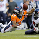 Denver Broncos cornerback Bradley Roby (29) breaks up a pass intended for Houston Texans wide receiver Andre Johnson (80) during the first half of an NFL preseason football game, Saturday, Aug. 23, 2014, in Denver The Associated Press