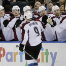 Colorado Avalanche's Matt Duchene (9) celebrates with teammates after scoring a goal during the first period of an NHL hockey game against the New York Rangers, Thursday, Nov. 13, 2014, in New York The Associated Press