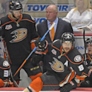 In this May 16, 2014 file photo, Anaheim Ducks right wing Teemu Selanne (8), of Finland, takes to the ice as head coach Bruce Boudreau, upper center, looks on along with center Nick Bonino during the third period in Game 7 of an NHL hockey second-round St
