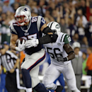 New England Patriots tight end Rob Gronkowski (87) runs from New York Jets inside linebacker Demario Davis (56) after catching a pass during the second half of an NFL football game Thursday, Oct. 16, 2014, in Foxborough, Mass The Associated Press