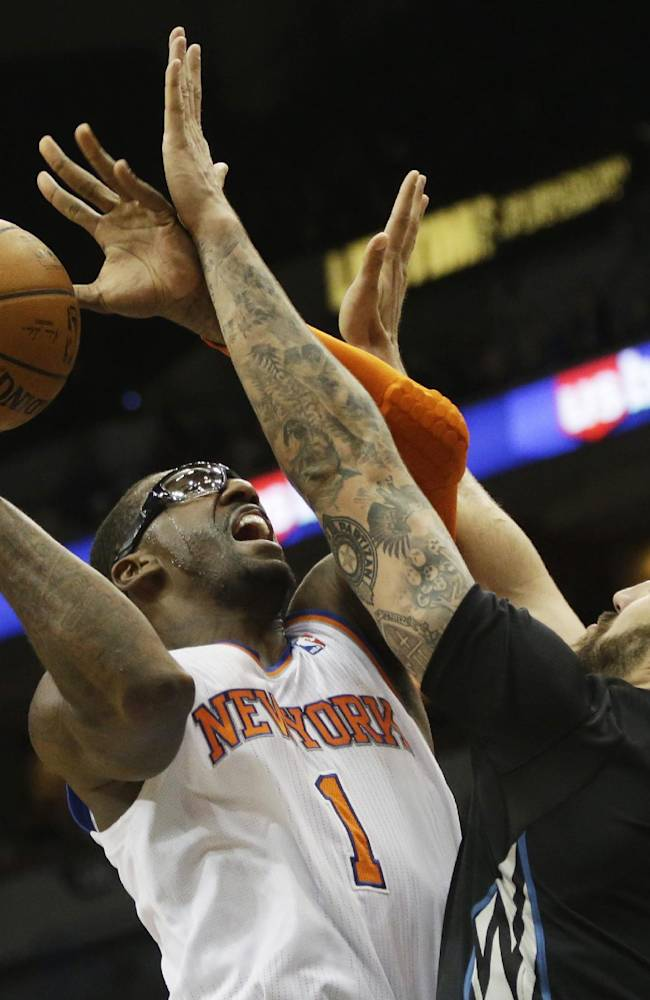 Minnesota Timberwolves' Nikola Pekovic, right, of Montenegro, tries to block a shot by New York Knicks' Amar'e Stoudemire in the second half of an NBA basketball game, Wednesday, March 5, 2014, in Minneapolis. The Knicks won 118-106