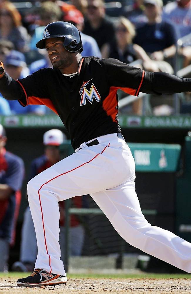 Miami Marlins' Alfredo Silverio grounds into a force out to score teammate Marcell Ozuna in the seventh inning of an exhibition spring training baseball game against the Washington Nationals, Saturday, March 15, 2014, in Jupiter, Fla