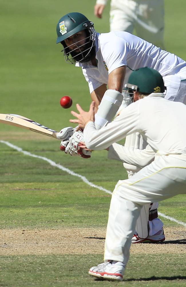 South Africa's batsman Hashim Amla, top, watches as Australia's fielder Steven Smith, bottom, fields off his shot on the third day of their 2nd cricket test match at St George's Park in Port Elizabeth, South Africa, Saturday, Feb. 22, 2014