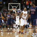 Southern California's Eric Wise (34) celebrates as Arizona's Solomon Hill (44) walks past during the final seconds of an NCAA college basketball game in Los Angeles, Wednesday, Feb. 27, 2013. USC won 89-78. (AP Photo/Jae C. Hong)
