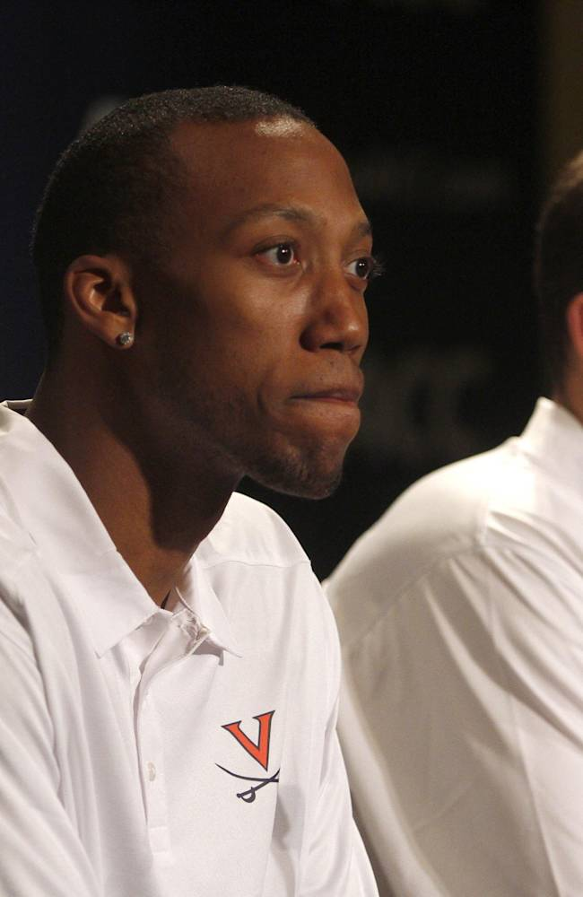 Virginia basketball players Akil Mitchell, left, and Joe Harris listen to a question at a press conference during the NCAA college Atlantic Coast Conference media day in Charlotte, N.C., Wednesday, Oct. 16, 2013