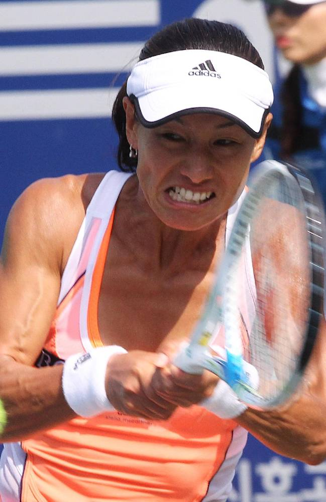 Japan's Kimiko Date Krumm returns a shot against Great Britain's Heather Watson during the first round match of the Korea Open tennis championships in Seoul, South Korea, Tuesday, Sept. 17, 2013. Date Krumm won the match with 3-6, 6-3, 6-4