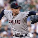 Cleveland Indians starting pitcher Corey Kluber throws against the Seattle Mariners during the first inning of a baseball game Thursday, May 28, 2015, in Seattle. (AP Photo/Elaine Thompson)