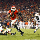 Georgia running back Todd Gurley (3) runs between Auburn linebacker Justin Garrett (26) and Auburn linebacker Cassanova McKinzy (8) to score a touchdown in the second half of an NCAA college football game Saturday, Nov. 15, 2014, in Athens, Ga. (AP Photo/John Bazemore)