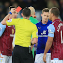 Aston Villa's Ciaran Clark, left, is sent off by referee Michael Oliver during the English Premier League soccer match against Leicester City at the King Power Stadium, Leicester, England, Saturday Jan. 10, 2015