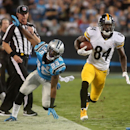 Pittsburgh Steelers' Antonio Brown (84) runs up the sideline, escaping the tackle by Carolina Panthers' Bene Benwikere during an NFL football game Sunday, Sept. 21, 2014, in Charlotte, N.C The Associated Press