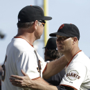 San Francisco Giants pitcher Tim Hudson, right, celebrates with manager Bruce Bochy after the Giants defeated the Arizona Diamondbacks 7-3 in a baseball game in San Francisco, Tuesday, April 8, 2014. Hudson was the winning pitcher The Associated Press