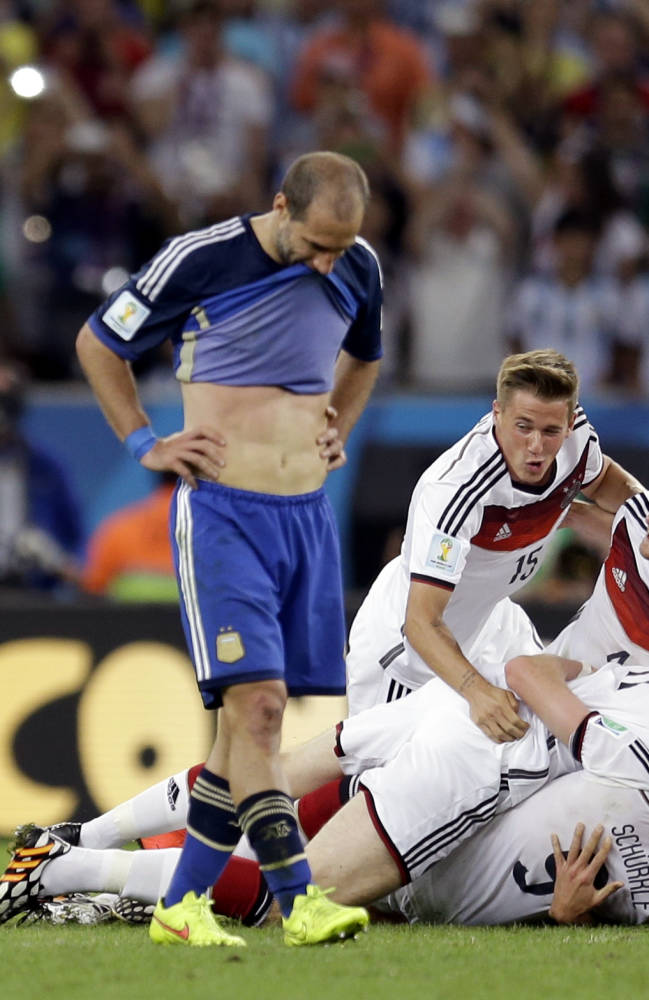 German players celebrate after Germany's 1-0 World Cup victory in extra time during the final soccer match between Germany and Argentina at the Maracana Stadium in Rio de Janeiro, Brazil, Sunday, July 13, 2014. (AP Photo/Natacha Pisarenko)
