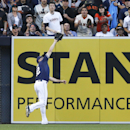 San Diego Padres left fielder Seth Smith makes the running catch at the wall to rob San Francisco Giants' Joaquin Arias in the fifth inning of a baseball game Saturday, April 19, 2014, in San Diego The Associated Press