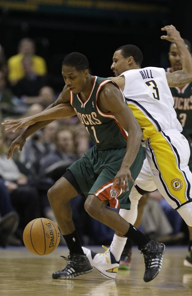 Milwaukee Bucks' Brandon Knight (11) is defended by Indiana Pacers' George Hill (3) during the second half of an NBA basketball game on Thursday, Feb. 27, 2014, in Indianapolis. Indiana defeated Milwaukee 101-96