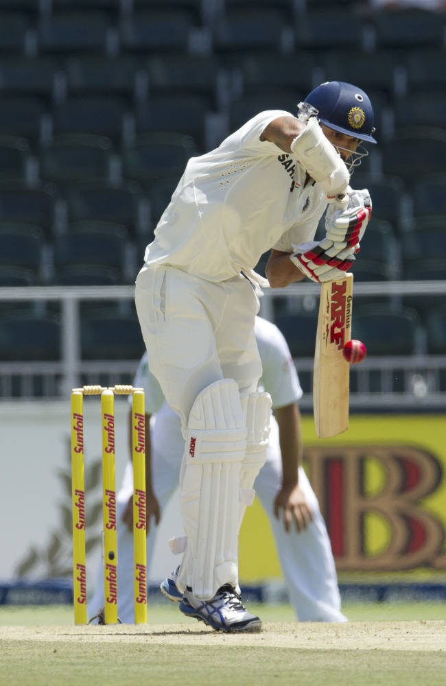 India's batsman Shikhar Dhawan, plays a shot during the first day of their cricket test match against South Africa at Wanderers stadium in Johannesburg, South Africa, Wednesday, Dec. 18, 2013