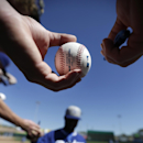 Mike Gilliland, above, waits with a baseball for an autograph from Los Angeles Dodgers shortstop Hanley Ramirez, below, before the Dodgers play the Oakland Athletics in a spring training baseball game Monday, March 3, 2014, in Phoenix The Associated Pres