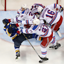 St. Louis Blues center Paul Stastny (left) is knocked down by New York Rangers center Mats Zuccarello (36) and defenseman Ryan McDonagh (27) in second period action during the NHL hockey game between the St. Louis Blues and the New York Rangers on Thursda