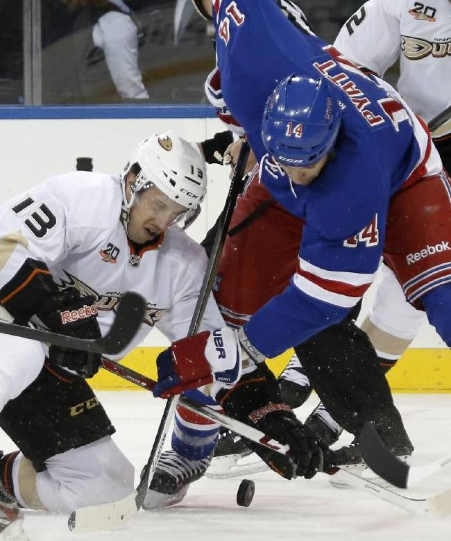 Anaheim Ducks center Nick Bonino (13) and New York Rangers left wing Taylor Pyatt (14) scramble for puck control during a first period face off  in their NHL hockey game at Madison Square Garden in New York, Monday, Nov. 4, 2013.  The Ducks defeated the Rangers 2-1