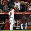 Los Angeles Angels' Mike Trout (27) acknowledges the crowd after he hits a solo home run in the eighth inning, hitting for the cycle against the Seattle Mariners during a baseball game Tuesday, May 21, 2013 in Anaheim.  The Angels won the game 12-0.   (AP Photo/Alex Gallardo)