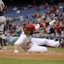 Washington Nationals' Jayson Werth (28) slides home to score on a hit by Adam LaRoche during the first inning of a baseball game against Miami Marlins catcher Jarrod Saltalamacchia (39), Tuesday, April 8, 2014, in Washington The Associated Press