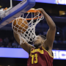 Cleveland Cavaliers' Tristan Thompson (13) makes an uncontested dunk against the Orlando Magic during the first half of an NBA basketball game in Orlando, Fla., Wednesday, April 2, 2014 The Associated Press