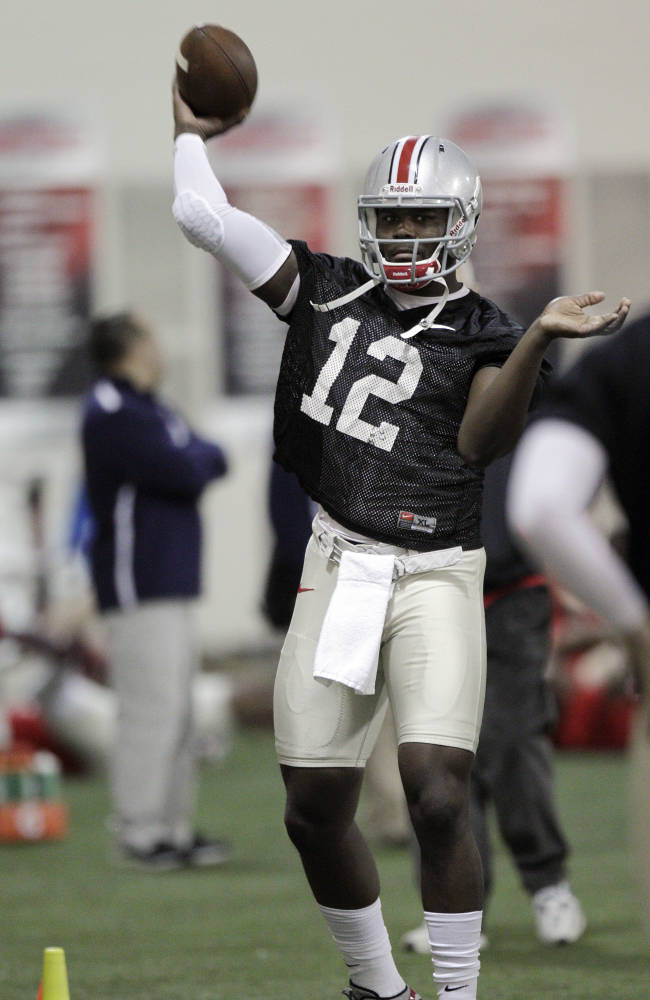 This March 4, 2014 shows Ohio State quarterback Cardale Jones warming up during a spring NCAA college football practice in Columbus, Ohio. A lot of the early preseason publications and websites figure Ohio State should have one of the top 10 or 15 teams in the country. If the Buckeyes live up to that hype, it'll likely be because of a lot of players who are unknown to even staunch fans