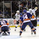 Pittsburgh Penguins' James Neal (18) and Chris Kunitz (14) celebrate Sidney Crosby's goal against New York Islanders goalie Anders Nilsson (45) in the third period of an NHL hockey game on Tuesday, Dec. 3, 2013, in Uniondale, N.Y. The Penguins won 3-2 in