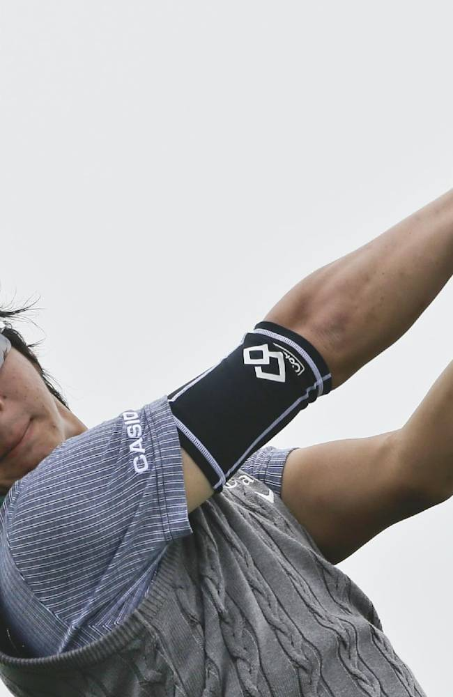 Ryo Ishikawa, of Japan, drives on 4th hole of the South Course at Torrey Pines during the final round of the Farmers Insurance Open golf tournament Sunday, Jan. 26, 2014, in San Diego