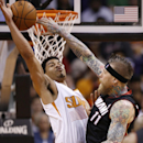 Miami Heat's Chris Andersen (11) gets his shot blocked by Phoenix Suns' Gerald Green during the second half of an NBA basketball game Tuesday, Feb. 11, 2014, in Phoenix The Associated Press