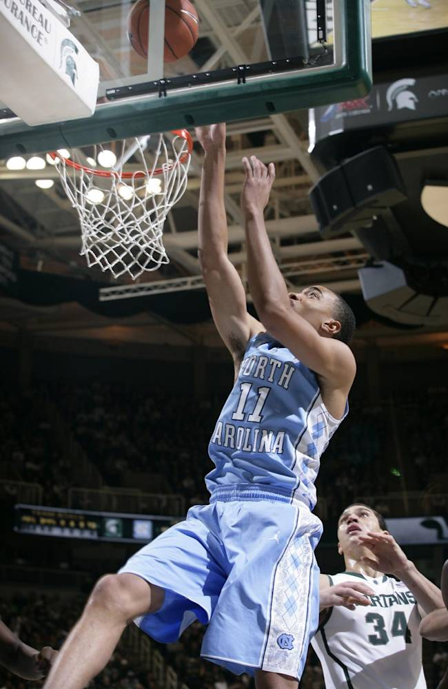 North Carolina's Brice Johnson (11) shoots over Michigan State's Gavin Schilling (34) during the first half of an NCAA college basketball game, Wednesday, Dec. 4, 2013, in East Lansing, Mich. North Carolina won 79-65