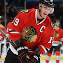 Chicago Blackhawks center Jonathan Toews grabs his hand after after bumping it  as the Blackhawks defeated the Minnesota Wild
