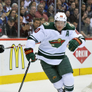 In this Wednesday, April 30, 2014 file photo, Minnesota Wild defenseman Ryan Suter skates against the Colorado Avalanche in the first period during Game 7 of an NHL hockey first-round playoff series in Denver. Multiple players on multiple teams across th