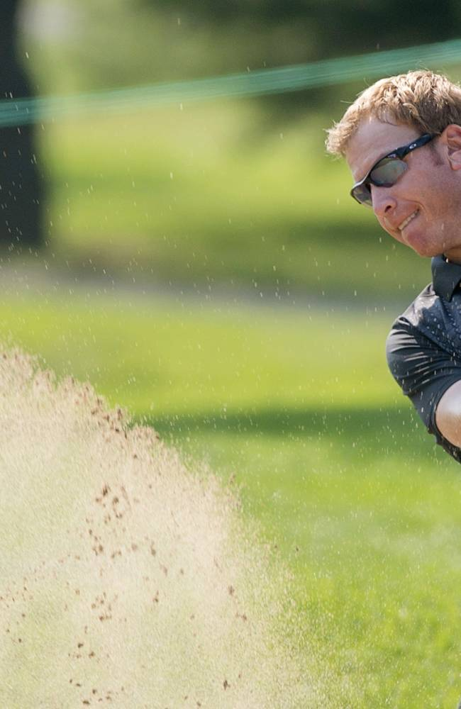 Ricky Barnes, from the United States, plays a bunker shot during a practice round at the Canadian Open golf tournament at Royal Montreal Golf Club in Montreal, Quebec, Tuesday, July 22, 2014