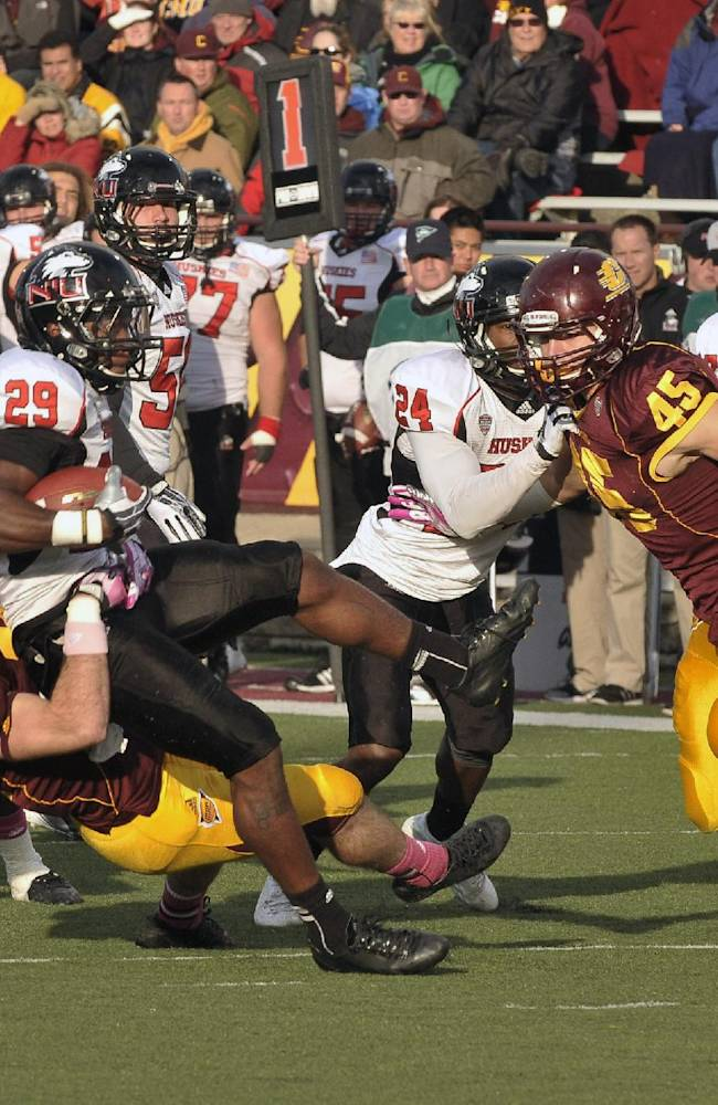 Northern Illinois's Paris Logan is hauled down during the fourth quarter pf an NCAA college football game against Central Michigan in Mount Pleasant, Mich., Saturday, Oct. 19,2013 . N. Illinois won, 38-17