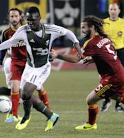 Portland Timbers' Kalif Alhassan (11)works against Real Salt Lake's Kyle Beckerman (5) during the first half of an MLS Soccer game in Portland, Ore., Saturday, Oct. 19, 2013. (AP Photo/Greg Wahl-Stephens)
