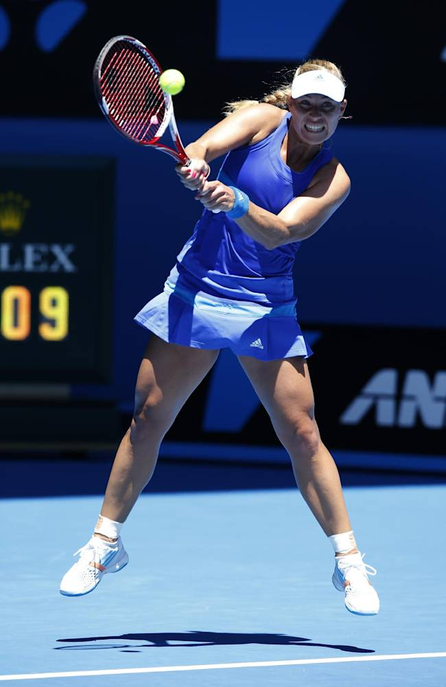 Angelique Kerber of Germany makes a backhand return to Jarmila Gajdosova of Australia during their first round match at the Australian Open tennis championship in Melbourne, Australia, Monday, Jan. 13, 2014
