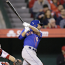 New York Mets' Omar Quintanilla hits a two-RBI single during the ninth inning of a baseball game against the Los Angeles Angels on Saturday, April 12, 2014, in Anaheim, Calif The Associated Press