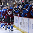 Colorado Avalanche center Nathan MacKinnon (29) celebrates a goal against the Minnesota Wild in the first period of Game 2 of an NHL hockey first-round playoff series on Saturday, April 19, 2014, in Denver The Associated Press
