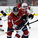 Washington Capitals defenseman John Carlson (74) goes for the puck against Ottawa Senators center Jason Spezza (19) in the third period of an NHL hockey game, Wednesday, Nov. 27, 2013, in Washington. The Senators won 6-4 The Associated Press