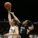 Stanford 's Toni Kokenis (31) jumps for a rebound next to Colorado 's Ashley Wilson (12) during the first half of an NCAA college basketball game in Stanford, Calif., Sunday, Jan. 27, 2013. (AP Photo/Marcio Jose Sanchez)