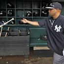New York Yankees' Carlos Beltran tosses his bat into the bat rack after taking batting practice at McKechnie Field before an exhibition spring training baseball game against the Pittsburgh Pirates in Bradenton, Fla., Wednesday, Feb. 26, 2014 The Associat