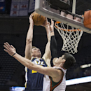 Milwaukee Bucks' Ersan Ilyasova, right, tries to stop Utah Jazz Gordon Hayward during the second half of an NBA basketball game Monday, March 3, 2014, in Milwaukee The Associated Press