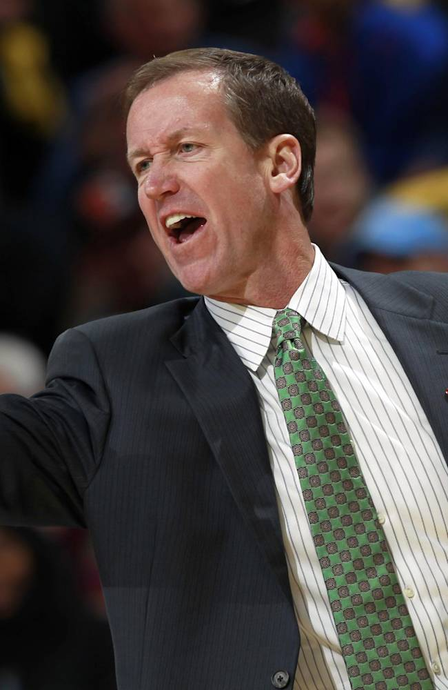 Portland Trail Blazers head coach Terry Stotts directs his team against the Denver Nuggets in the first quarter of an NBA basketball game in Denver on Friday, Nov. 1, 2013