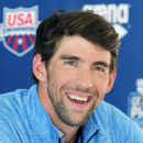 Michael Phelps speaks to the media after practice, Wednesday, April 23, 2014, in Mesa, Ariz. Phelps is competing in the Arena Grand Prix at Mesa on Thursday as he returns to competitive swimming after a nearly two-year retirement. (AP Photo/Matt York)